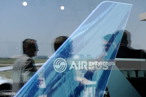 Guests attend on July 19 2013 the delivery of the 1000th Airbus A330 to Cathay Pacific Airways at Toulouse airport The aircraft an A330300 powered by...
