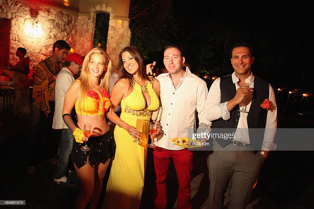 Guests attend Sir Ivan's celebration of his new hit single 'Here Comes the Sun' at his castle in the Hamptons on August 23, 2014 in Water Mill, New York.