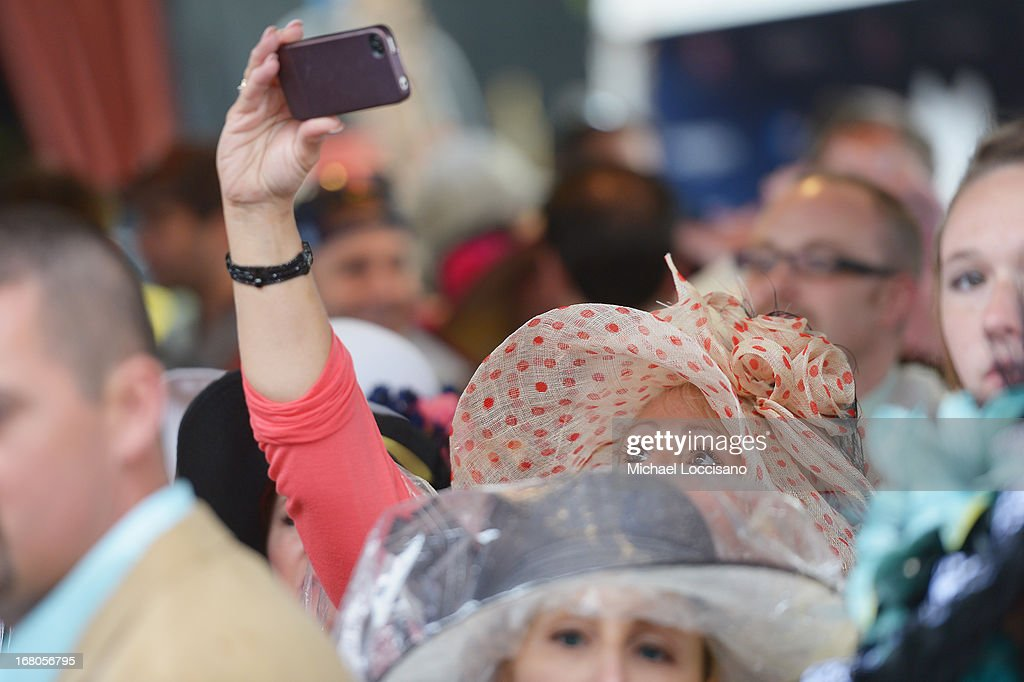 Guests attend the 139th Kentucky Derby at Churchill Downs on May 4, 2013 in Louisville, Kentucky.