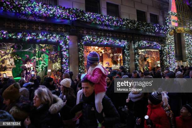 Guests attend the 2017 Saks Fifth Avenue Holiday Window Unveiling And Light Show at Saks Fifth Avenue on November 20 2017 in New York City