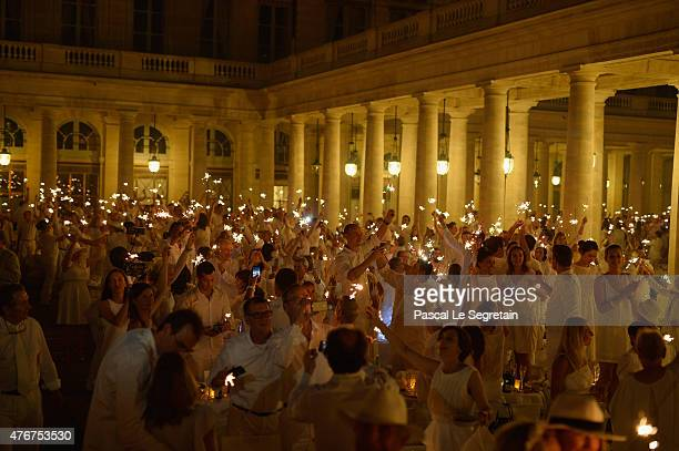 Guests attend The 27th 'Diner En Blanc' Dinner In White In Paris on June 11 2015 in Paris France