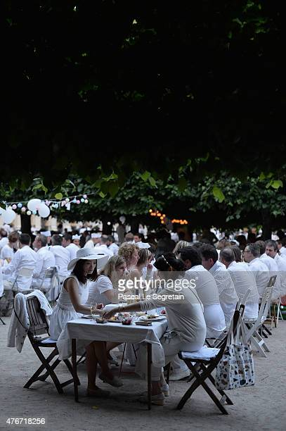 Guests attend the 27th 'Diner En Blanc' Dinner in White on June 11 2015 in Paris France The dinner is a secret popup style event originally started...