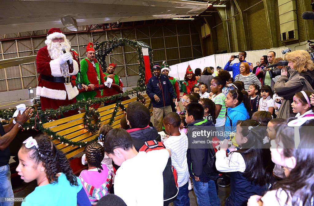 Guests attend the 3rd Annual Garden of Dreams Foundation & Delta Air Lines' 'Holiday in the Hangar' event at John F. Kennedy International Airport on December 11, 2012 in New York City.