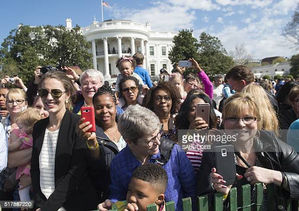 Guests attend the annual Easter Egg Roll on the South Lawn of the White House in Washington DC March 28 2016 Some 35000 guests have been invited to...