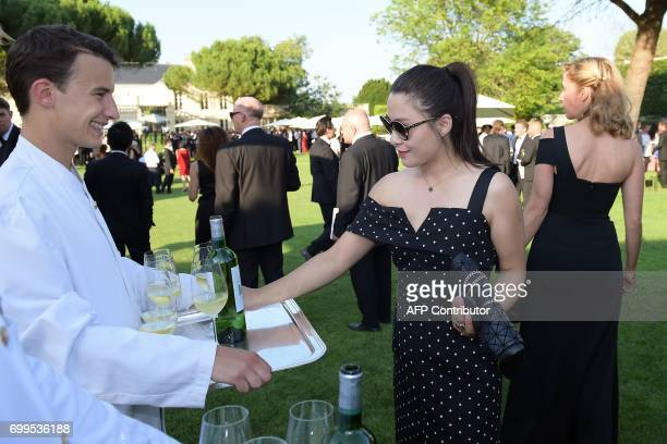 CORRECTION Guests attend the cocktail opening of the 65th 'Fete de la Fleur' at Chateau MalarticLagraviere in Leognan southwestern France on June 21...