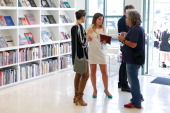 Guests attend the Culver City Artist Tour Party at Arcana Books on the Arts on June 21 2014 in Culver City California