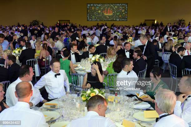 CORRECTION Guests attend the dinner during the 65th 'Fete de la Fleur' at Chateau MalarticLagraviere in Leognan southwestern France on June 21...