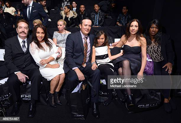 Guests attend the FLT Moda Art Hearts Fashion show presented by AIDS Healthcare Foundation during MercedesBenz Fashion Week Fall 2014 at The Theatre...