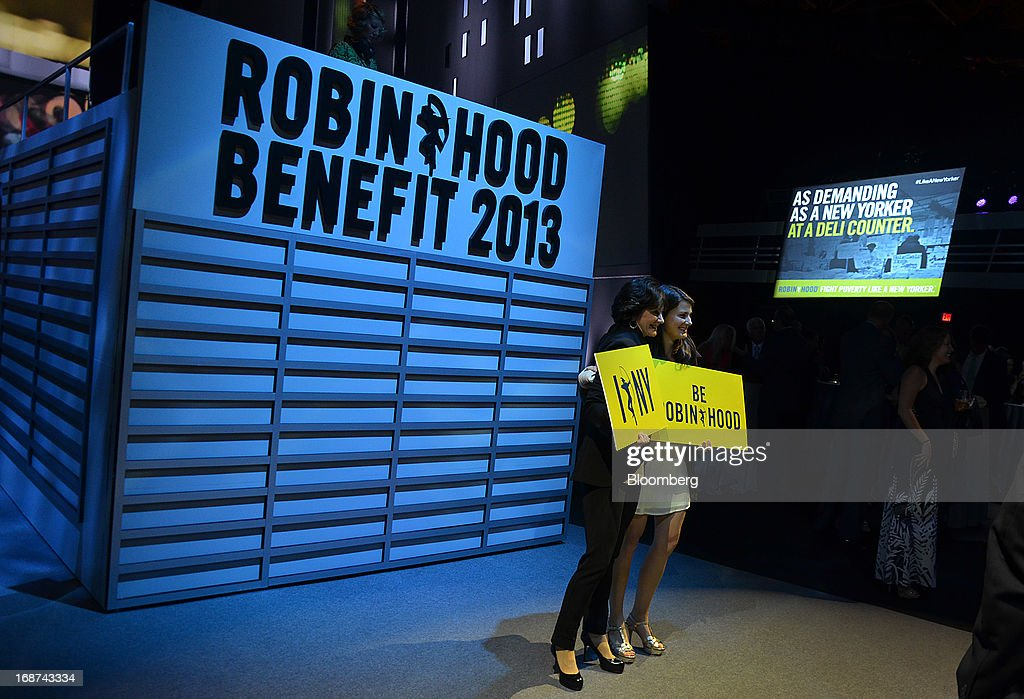 Guests attend the Robin Hood Foundation Gala in New York, U.S., on Monday, May 13, 2013. The annual event raises money for the Robin Hood Foundation, which funds and partners with programs to alleviate poverty in the lives of New Yorkers. Photographer: Amanda Gordon/Bloomberg via Getty Images