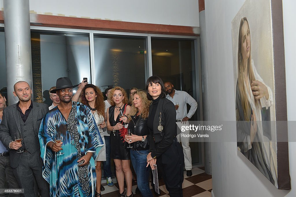 veiled Exhibit At Avant Gallery, Featuring The Unveiling Of 'The Most Beautiful Woman In The World' Painting at Epic Hotel on December 3, 2013 in Miami, Florida.
