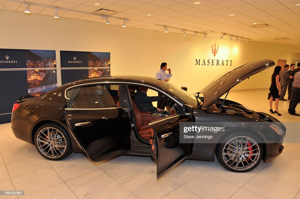 Guests attend the unveiling of the new Maserati Quattroporte at Ferrari Maserati Silicon Valley on April 3, 2013 in Redwood City, California.