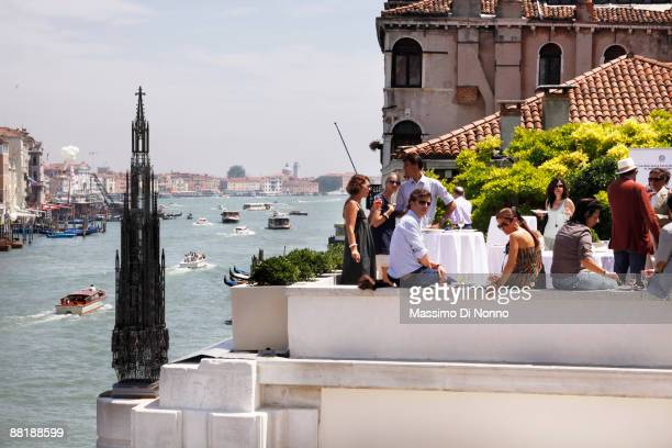 Guests attend the Vim Delvoye opening exhibition at the Peggy Guggenheim Collection during the 2009 Venice Biennale on June 3 2009 in Venice Italy