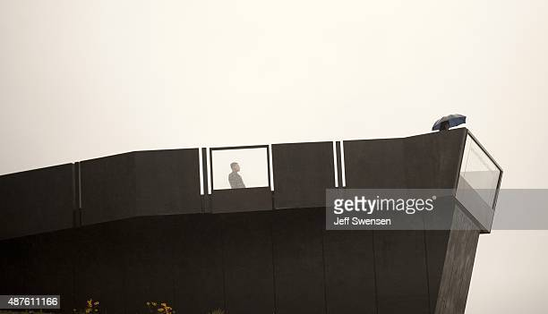 Guests brave the rain at the visitor center at the Flight 93 National Memorial on September 10 2015 in Shanksville Pennsylvania The newly opened $26...
