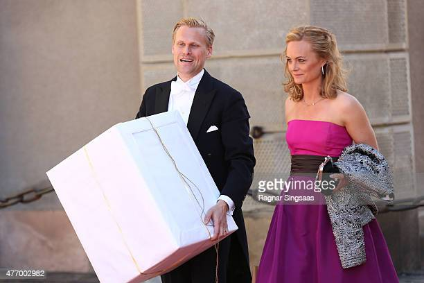 Guests bring gifts as they arrive to the royal wedding of Prince Carl Philip of Sweden and Sofia Hellqvist at The Royal Palace on June 13 2015 in...