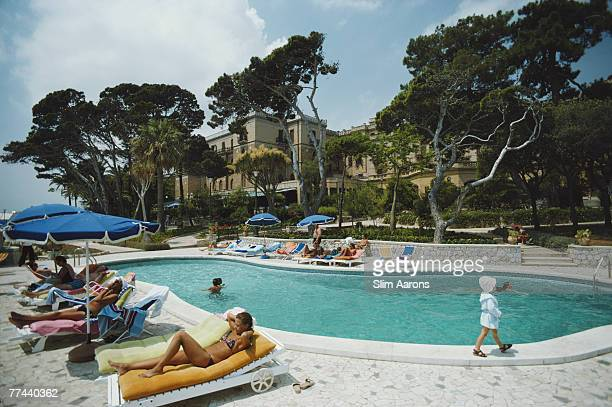 Guests by the pool at Hotel Villa Igra Taormina Sicily August 1975