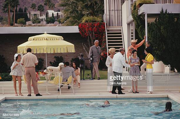 Guests by the pool at Nelda Linsk's desert house in Palm Springs California January 1970 The house was designed by Richard Neutra for Edgar J...