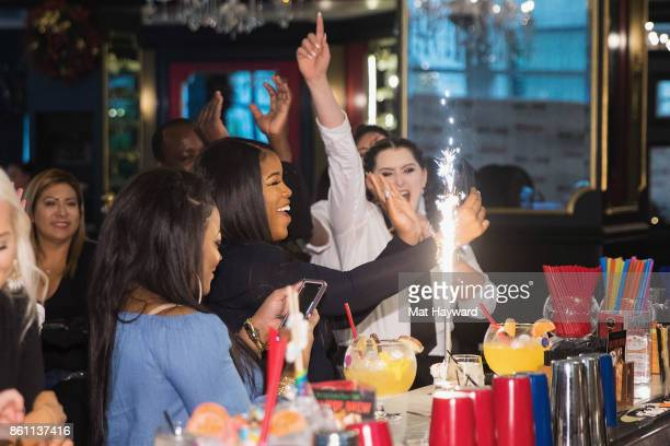 Guests celebrate a birthday with a King Kong Sundae and sparklers as Scott Disick visits the Sugar Factory American Brassiere on October 13 2017 in...