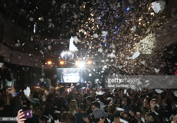 Guests celebrate at the strike of midnight during the NHL Centennial Classic New Year's Eve Celebration at Muzik Event Center on January 1 2017 in...