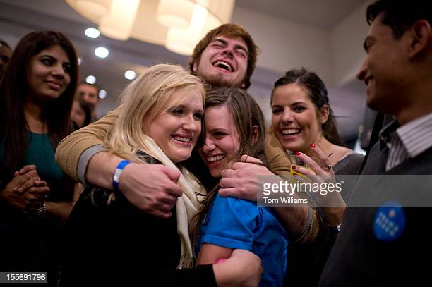 Guests celebrate during a DSCC/DCCC election night watch party at the Liaison Capitol Hill hotel as a newscast announced Barack Obama won reelection...