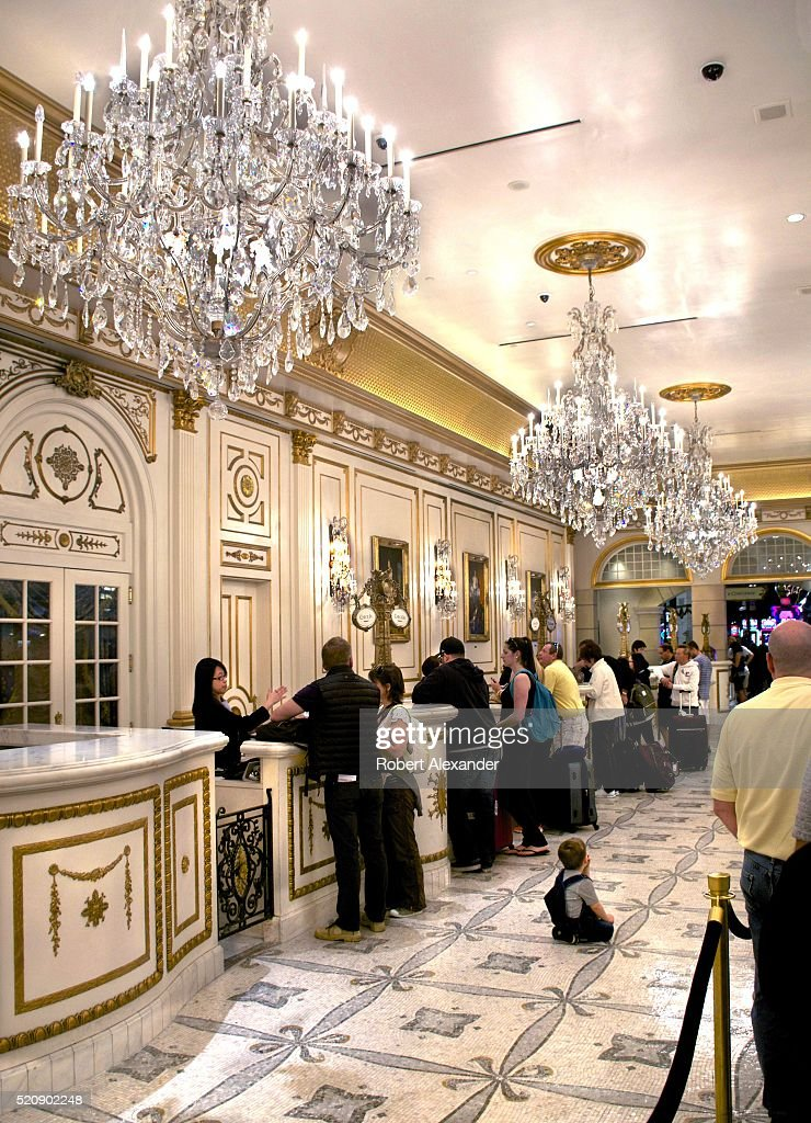 Guests Check In At The French Themed Paris Las Vegas Hotel
