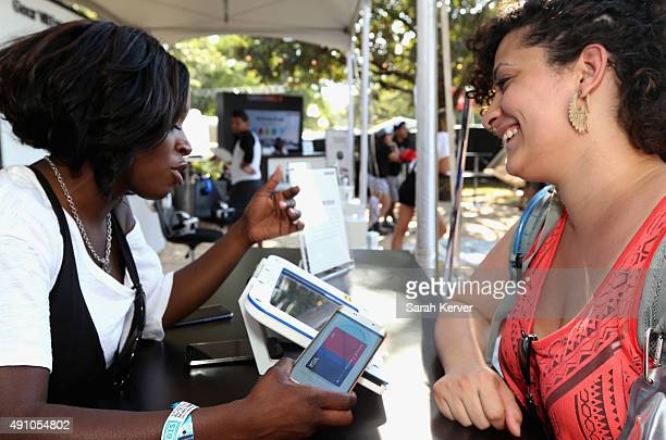 Guests check out a Samsung Pay station at Austin City Limits Music Festival 2015 Samsung Pay is the Official Mobile Payment Solution of the festival...