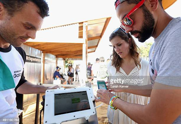 Guests check out a Samsung Pay station at Austin City Limits Music Festival 2015 on October 3 2015 in Austin Texas Samsung Pay is the Official Mobile...