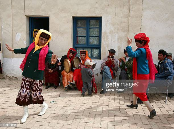 Guests dance during a wedding ceremony of Tajik ethnic minority group on September 24 2006 in Taxkorgan County of Kashi Prefecture Xinjiang Uygur...