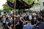 Guests dance their way through the streets after scribed pens the final letters on a newly dedicated Torah scroll in the Chabad Synagogue on May 7...