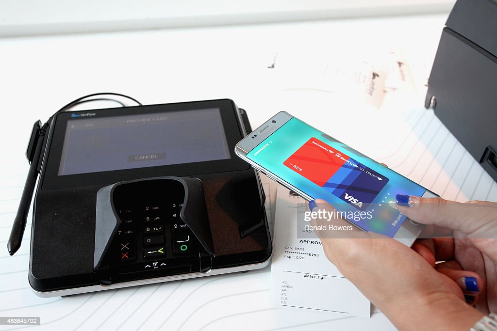 Guests demo Samsung Pay a new mobile payment service that works virtually anywhere you can swipe your card at Samsung Unpacked 2015 on August 13 2015...
