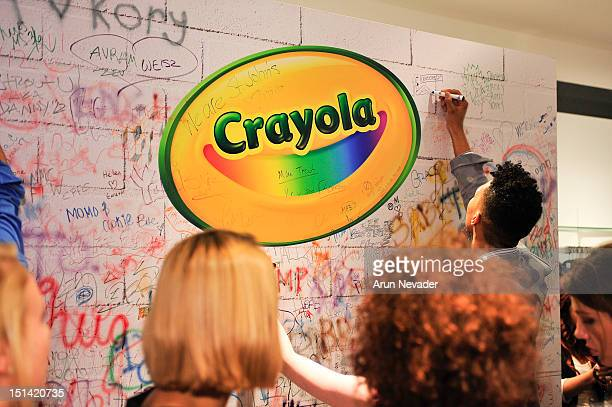 Guests draw on the crayon wall at Saks Fifth Avenue on September 6 2012 in New York City