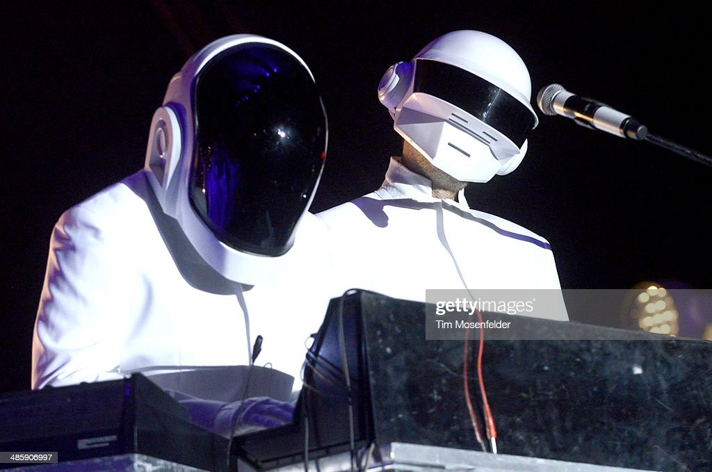 Guests dressed as Daft Punk performs with Arcadw Fire at the Coachella Valley Music and Arts Festival at The Empire Polo Club on April 20, 2014 in Indio, California.