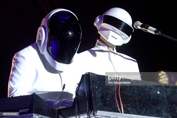 Guests dressed as Daft Punk performs with Arcadw Fire at the Coachella Valley Music and Arts Festival at The Empire Polo Club on April 20 2014 in...