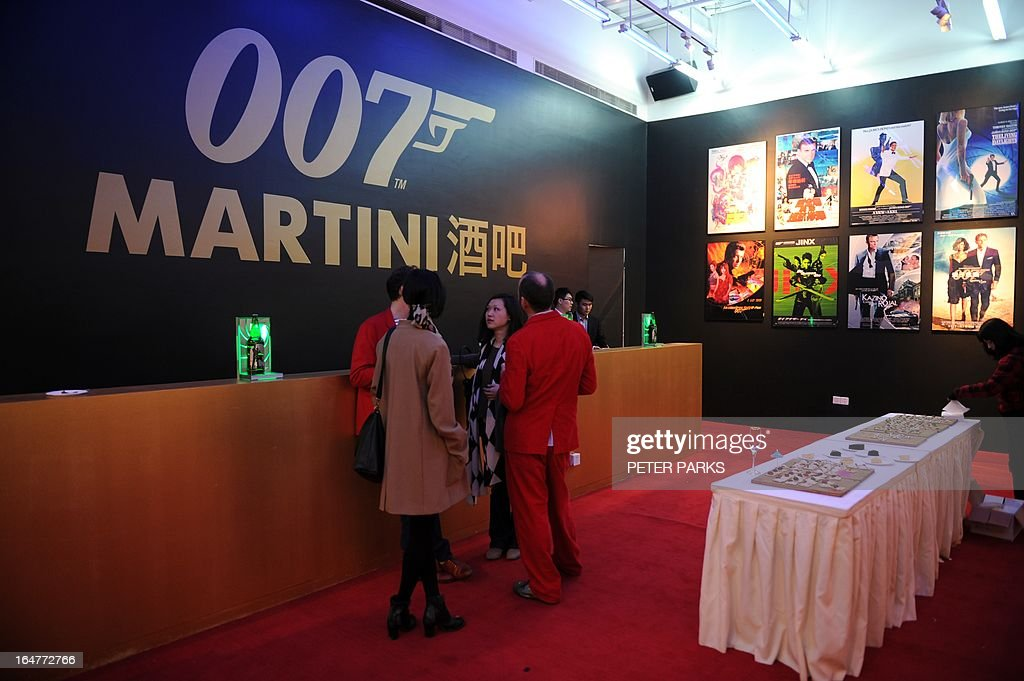 Guests drink at the Martini Bar at an exhibition on the fictional British spy James Bond in Shanghai on March 28, 2013. The exhibition opened in Shanghai just weeks after the Communist government's censors cut parts of the latest film in the franchise, 'Skyfall' with a scene showing prostitution in Macau, a special administrative region of China, was removed, as was a line in which Bond's nemesis mentions being tortured by Chinese security agents. Peter PARKS