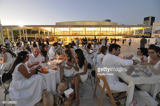 Guests during the first ever White Dinner that took place in Tel Aviv Hundreds of people dressed in white came for a picnick on the public square of...