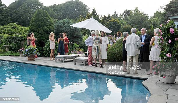 Guests enjoy a cocktail party introducing Friends of Quinn Understood The National Center for Learning Disabilities partnership at Grey Gardens on...