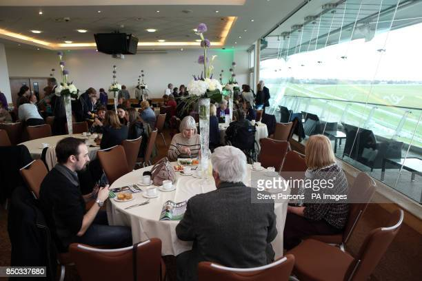 Guests enjoy a dinner reception after the unveiling of a Plaque for Emily Davison at Tattenham Corner at Epsom Downs Racecourse