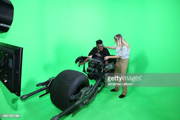 Guests enjoy a green screen installation at the Warner Bros Studio Tour Hollywood Expansion Official Unveiling Stage 48 Script To Screen at Warner...