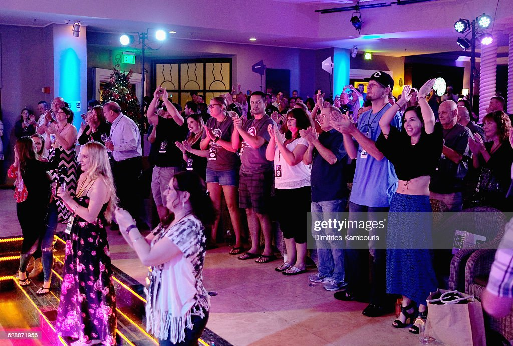 Guests enjoy a performance by Eli Young Band during CMT Story Behind The Songs LIV + Weekend at Sandals Royal Bahamian Spa Resort & Offshore Island - Day 2 at Sandals Royal Bahamian on December 9, 2016 in Nassau, Bahamas.