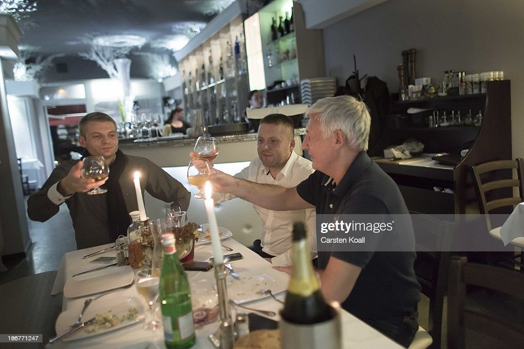 Guests enjoy dinner in Russian restaurant 'Karat' in Charlottenburg district on November 02, 2013 in Berlin, Germany. According to recently published statistics, 7.2 million foreigners were living in Germany by the end of 2012, which is the highest number ever recorded. Of those 80% are from countries in the European Union, while the rest come primarily from Turkey, Russia, the former Soviet states and Arab countries.