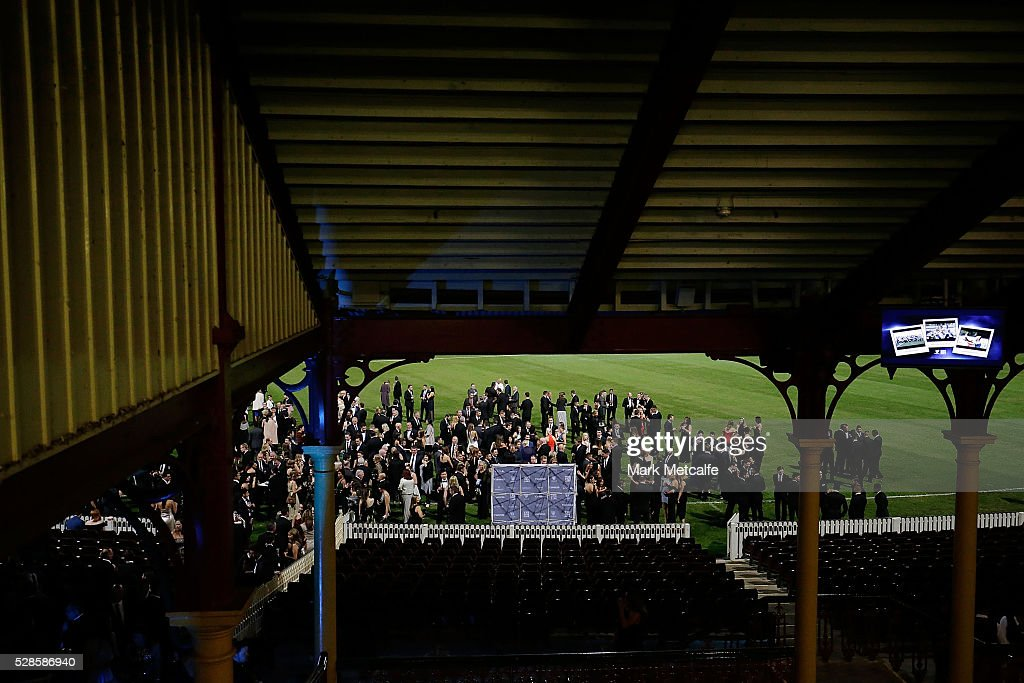 Guests enjoy drinks on the pitch before the Sydney FC Sky Blue Ball at the Sydney Cricket Ground on May 6, 2016 in Sydney, Australia.