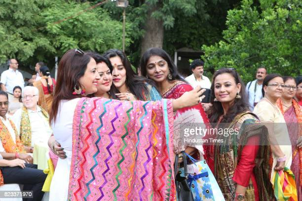 Guests enjoy during the Teej festival celebrations organised at the residence of Union Minster Smriti Irani on July 25 2017 in New Delhi India The...