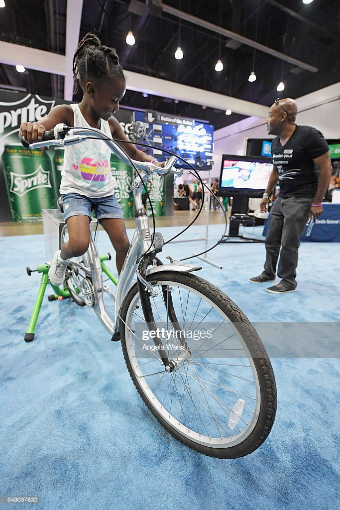 Guests enjoy exhibits at FAN FEST during the 2016 BET Experience on June 25, 2016 in Los Angeles, California.