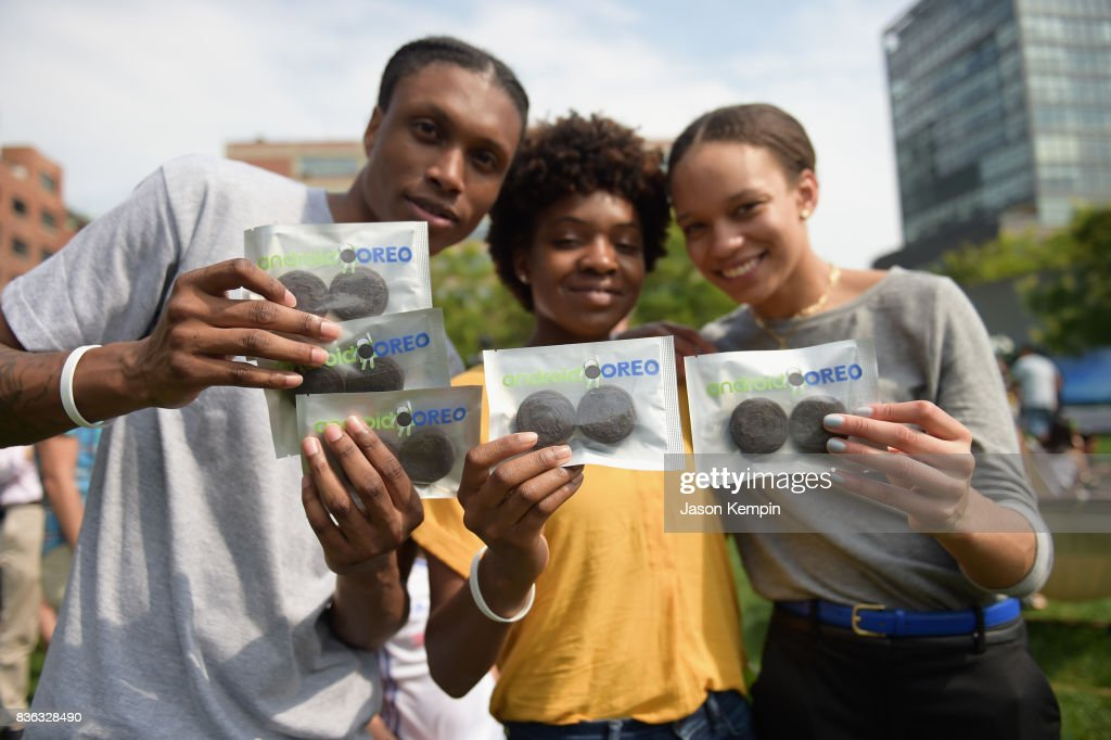 Guests enjoy Oreo cookies as Google and Oreo reveal Android OREO during the solar eclipse at the 14th street park on August 21, 2017 in New York City.