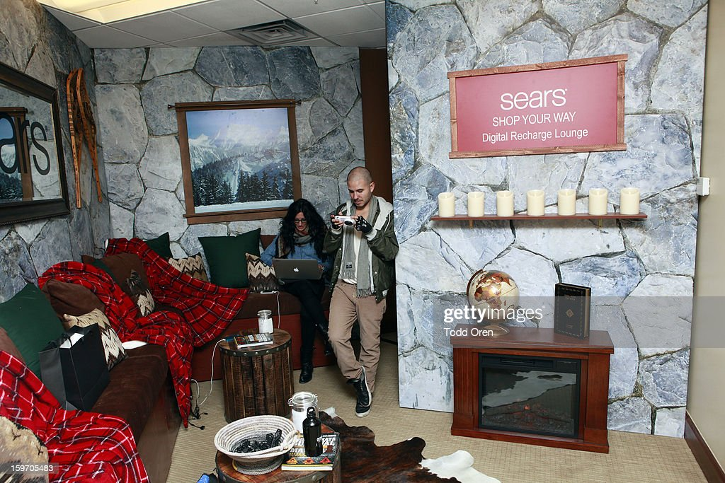Guests enjoy Sears Shop Your Way Digital Recharge Lounge on January 18, 2013 in Park City, Utah.