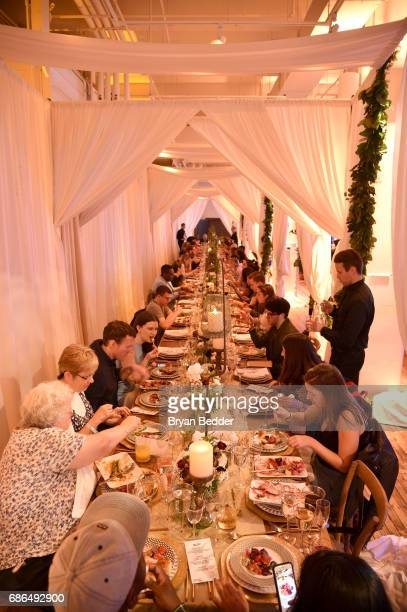 Guests enjoy the dishes prepared by Jamie Bissonnette during TNT's Will Dinner By Toro's Chef Jamie Bissonette presented by TNT'S Supper Club at West...