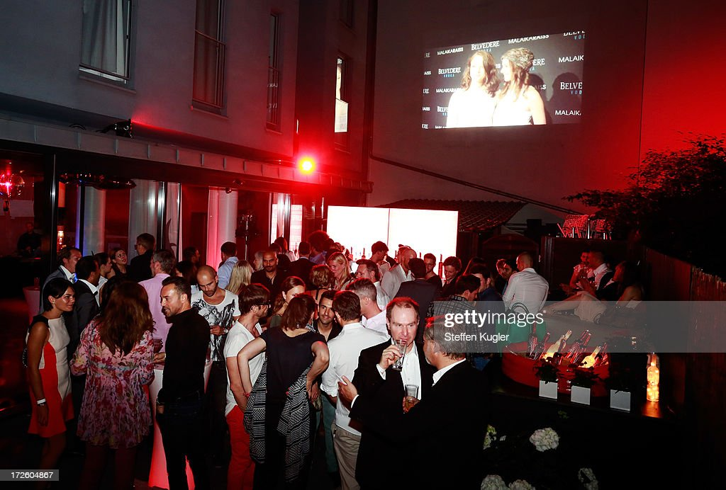 Guests enjoy the party at the NightShot Event during Berlin Fashion Week on July 3, 2013 in Berlin, Germany.