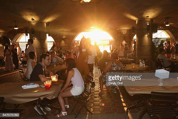 Guests enjoy the sunset at The 7th Annual Saveur Summer Cookout at Boat Basin Cafe on June 21 2016 in New York City