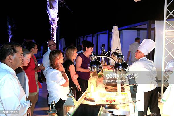 Guests enjoying the food during the welcome party at the Puro Beach Pool area at the Jebel Ali Golf Spa Resort as a preview for the 2015 Omega Dubai...