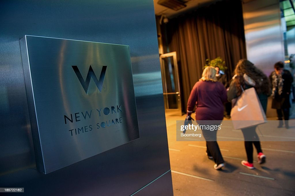 Guests enter the W Hotel New York - Times Square, a Starwood Hotels & Resorts Worldwide Inc. property, in New York, U.S., on Wednesday, Oct. 23, 2013. Starwood Hotels & Resorts Worldwide Inc., the owner of the Sheraton and W brands, rose the most in three months after it reported third-quarter earnings that beat estimates and forecast an increase in revenue growth for 2014. Photographer: Craig Warga/Bloomberg via Getty Images