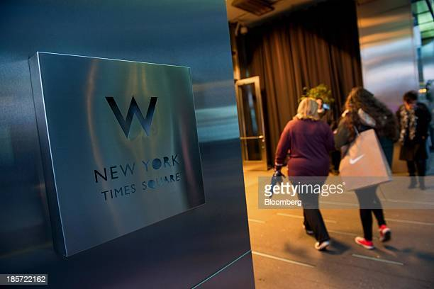 Guests enter the W Hotel New York Times Square a Starwood Hotels Resorts Worldwide Inc property in New York US on Wednesday Oct 23 2013 Starwood...